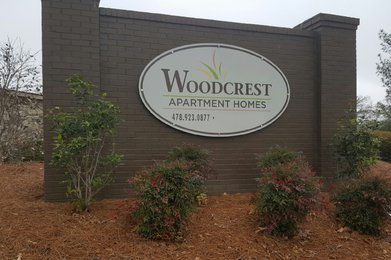 Woodcrest Apartment Homes sign